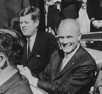John Glenn with President John F. Kennedy in a celebrational parade, 1962. Photo Credit: Unknown (U.S. National Archives and Records Administration) [Public domain], via Wikimedia Commons