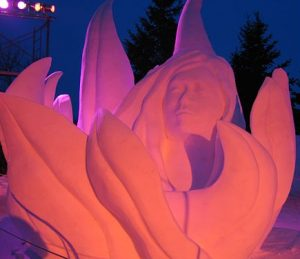 Snow Sculpture lit up at night, from the Festival du Voyageur in Winnipeg in 2014. Photo Credit: http://www.flickr.com/photos/mweriksson/ [CC BY 2.0], via Wikimedia Commons