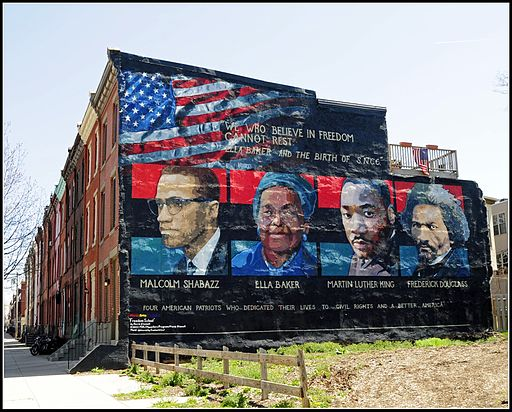 """We Who Believe in Freedom Cannot Rest"" Mural by Parris Stancell, in Philadelphia showing Malcolm X, Ella Baker, Martin Luther King, and Frederick Douglass. The quote is by Ella Baker (born on the second day of this trecena in 1903), who helped to organize Martin Luther King's Southern Christian Leadership Conference. At the present time the 5th day of this trecena coincides with the 122nd anniversary of the death of Frederick Douglass. Photo Credit: Tony Fischer [CC BY 2.0], via Wikimedia Commons"