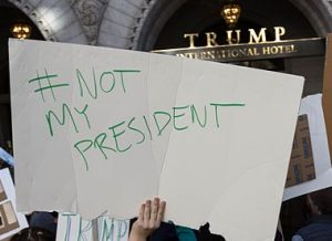 Not-My-President protest demonstration outside Trump Hotel in Washington DC, right after the election. Photo Credit: By Lorie Shaull [CC BY-SA 2.0], via Wikimedia Commons