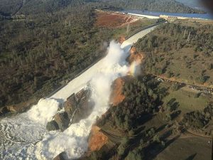 Water rushing through the Oroville Dam spillway, with the eroded section shown on the right, Feb. 11, 2017. Photo Credit: William Croyle, California Department of Water Resources [Public domain], via Wikimedia Commons